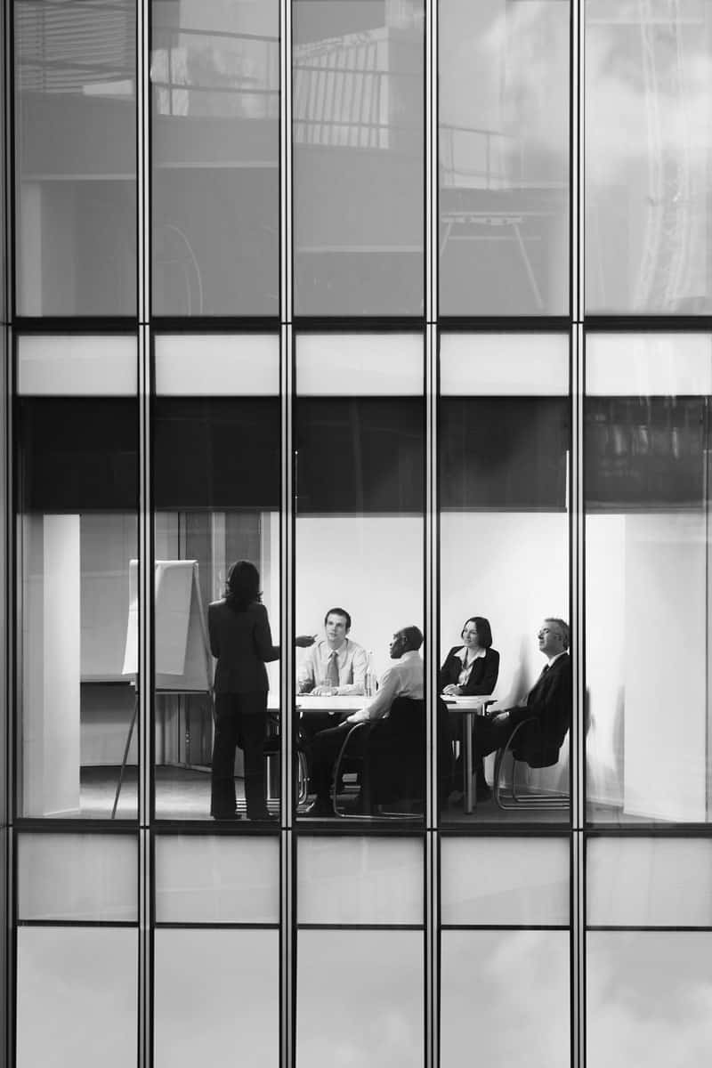 Team of professionals sitting at the desk in a meeting