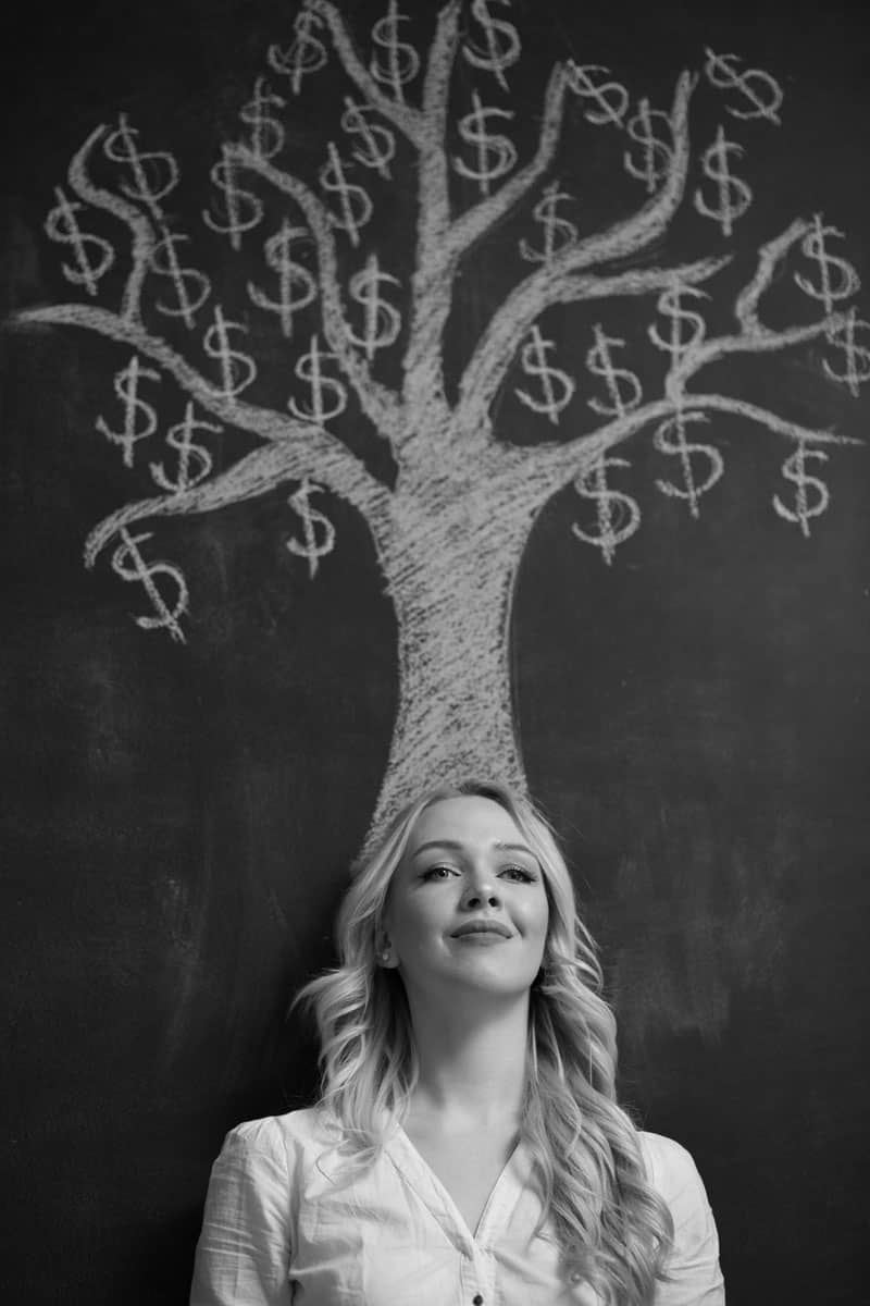 A woman smiling, where a money tree drawn on top of her